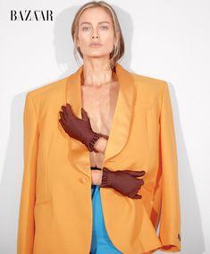 Carolyn Murphy stars in Harper's Bazaar US' March 2017 issue. The model wears Balenciaga jacket, gloves and leggings.