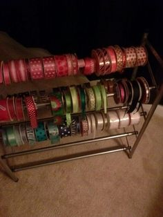 Craft ribbon holder using adjustable shoe rack. Fits perfect. Also holds rolls of deco mesh and tulle