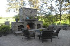 Outdoor Fireplace in Handcrafted Stone : French Country Limestone - Nitterhouse Masonry #patio #backyard #summer