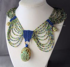 Egyptian style collar in micro macrame by Sherri Stokey.