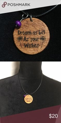 "Dreamer Necklace Beautiful necklace handmade by me. Wood boho style pendant engraved with the phrase Dream as big as your wishes and it has two dandelions. Pretty purple wood bead accent. Length of black waxed cord is 18"". This has a lobster clasp and chain extender on the back. New in package. Jewelry Necklaces"
