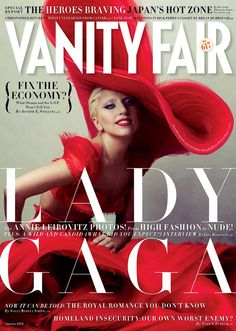 Lady Gaga appears on the cover of Vanity Fair January 2012 issue wearing a fantastic red dress and a flamboyant hat. Description from aroundtheworld-divaqueen.blogspot.com. I searched for this on bing.com/images