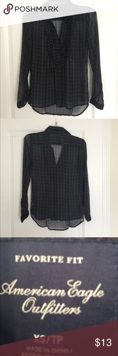 """American Eagle Outfitters Size XS sheer blouse. American Eagle Outfitters Size XS sheer dark blue on black with a dash of pink & purple plaid pattern, high low over blouse perfect with a cami or tank top.  Button cuff sleeve.  Bust 32"""", length 22"""".  Was coupled with a purple cami but she moved on to a blouse with a sunnier disposition. American Eagle Outfitters Tops Blouses"""