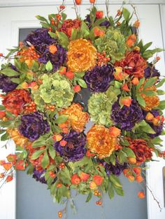 I was thinking Halloween when I was making this wreath.  I love the vibrant colors of purple, gold and rust.  It includes green hydrangeas,