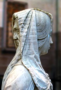 A statue representing Prudence, from the tomb of Francois II in Nantes Cathedral.  It shows the figure of a young girl - with the face of a wise old man on the back of her head.  Fulcanelli believed the statue symbolised nature in all of her aspects, and also the final stage of the alchemical process, in which opposites combine to produce the perfect, androgynous being.
