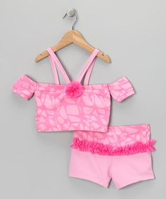 This sporty set boasts a cross-back crop top with vibrant embellishments like a bright print and frilly ruffle. Stretchy fabric and shorts with an elastic waistband keep girls comfortable during pirouettes, leaps and the occasional toe-touch. Includes top and shorts80% nylon / 20% spandexHand wash; hang dry
