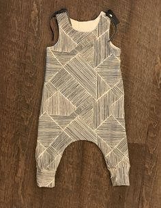 A personal favorite from my Etsy shop https://www.etsy.com/listing/537632819/baby-boy-harem-romperbaby-clothingharem