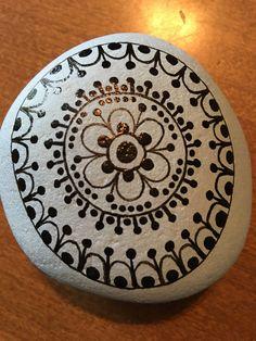 Mandala painted rock by GodsGlitter on Etsy