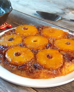 Pineapple Upside-Down Cake--      1 1/3 cups all-purpose flour     3/4 cup sugar     2 teaspoons baking powder     1/2 teaspoon salt     1/4 cup vegetable oil     3/4 cup milk     1 teaspoon vanilla     1 egg     Grated rind from 1 lime     1 tablespoon fresh lime juice     1/4 cup butter (1/2 stick)     1/2 cup dark brown sugar     1 fresh, ripe pineapple, sliced, or one 20-ounce can pineapple slices     15 pecans