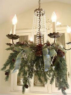 Rustic Christmas Chandelier, featuring greens and ribbon. Noel Christmas, Christmas Design, Rustic Christmas, Winter Christmas, Christmas Wreaths, Christmas Crafts, Vintage Christmas, Christmas Ideas, Office Christmas