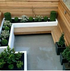 The modern garden bench made of wood adapts to any garden situation - small-london-garden-design-ideas-outdoor-indoor-theme. Garden Design London, London Garden, Modern Garden Design, Modern Garden Furniture, Modern Design, Wooden Garden Benches, Garden Seating, Terrace Garden, Small Terrace