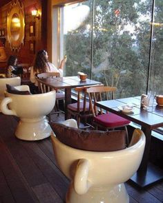 These teacup chairs add character and humor to the Cafe. The pillows on the teacup chairs adds warmth and comfort. The curved back encloses the users and makes them feel at home. This gives people something to remember that they will tell their friends about!