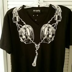 Rawyalty Bling T Shirt Headphone and Mic. Like new Gorgeous Rawality Apparel brand bling t shirt!  The design is very unique print with headphones and hanging microphone tastefully blinged with studs and rhinestones on a black cotton V neck shirt. Only worn once! Back of shirt has a microphone with brand name Rawality. Quality is great! May be worn by woman or men.Headphones on front of shirt sit right over breast area. Very sexy. Shirt is a large. May be worn like a tunic for smaller sizes…