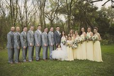 Yellow and Gray Wedding | Bridal Party Wedding Portrait with Yellow Bill Levkoff Bridesmaids Dresses and Ivory, Strapless Allure Lace Wedding Dress with White and Yellow Wedding Bouquet with Greenery | Sarasota Wedding Florist Andrea Layne Floral Design