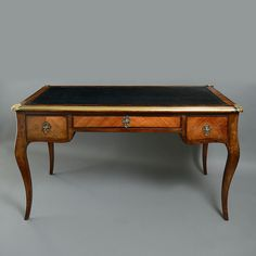 19th Century Bureau Plat or Writing Desk in the Louis XV Manner | From a unique collection of antique and modern desks and writing tables at https://www.1stdibs.com/furniture/tables/desks-writing-tables/