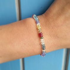 Do you want to see very beautiful play of flashes of gemstones on your hand?)) This bracelet has splendid rich red, pink, yellow, blue, green flashes of amazing natural ruby, tanzanite, aquamarine and topaz gemstone! Its really high fine quality of faceted beads will be wonderful to emphasize the beauty of your hand!) This bracelet is delicate and crystal - gemstones measure about 4 mm aprrox.  You can see more beautiful gemstones jewelry herehttp://etsy.me/2s0Q6Vp  Gemstone i...