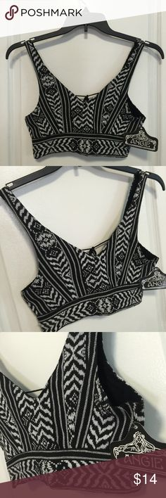 NWT ANGIE Black and White Crop top NWT Angie black And white crop top.Straps on the back with little bells at the end of them. Angie Tops Crop Tops