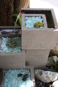 Great concrete fountain. Have to make one for the back yard! So cool!