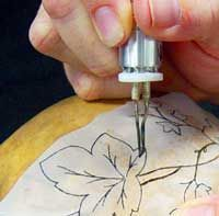 Special paper that allows you to burn design through paper onto gourd.