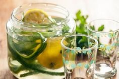 Treat yourself to a spa day at home with this simple mixture of cucumber- and lemon-infused water. A hint of parsley lends a clean, herbal flavor. Lemon Infused Water, Lemon Water, Infused Waters, Flavored Waters, Mint Water, Cucumber Detox Water, Lemon Diet, Spa Day At Home, Summer Berries