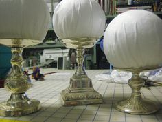 DIY Wig Stands - tall pillar candle holder craftg ball wrapped in fabric glue in place.