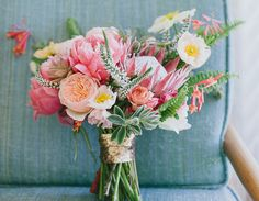 A mix of our favorite buds – peonies, poppies, succulents, protea – can steal the show | amazing summer wedding ideas