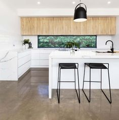 Modern kitchen with stained polished concrete floors white cabinets Modern Kitchen Design, Kitchen Designs, Polished Concrete, Concrete Floors, White Cabinets, Flooring, Table, Furniture, Home Decor