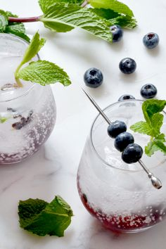 This twist on one of the classics makes it an easy crowd pleaser to serve at your next party. Fresh blueberries add a refreshing twist to a Cuban classic. Best Gin Cocktails, Rum Cocktail Recipes, Mint Mojito, Summer Drinks, Blueberries, Cuban, Crowd, Fresh, Classic