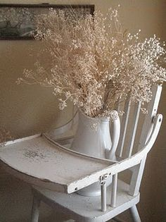 Love this old wooden high chair being used like this.