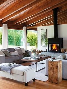 Grey Couches + Wood Tables      http://www.elmueble.com