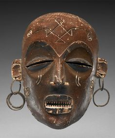 Africa | Female 'Pwo' mask from the Chokwe people | Wood and metal | ca. early 20th century