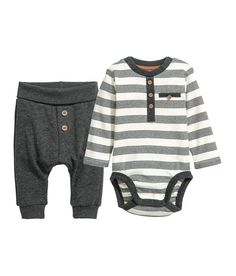 acad4cebb2a Check this out! CONSCIOUS. Set with a bodysuit and pants in soft organic  cotton