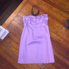 J.Crew Ruffle Strapless Dress Beautiful lilac ruffle top strapless dress. Perfect dress for a shower or outdoor wedding! You will get compliments on this dress! Only worn twice and in excellent condition. (Necklace not included but for sale in my closet)                          ✨100% cotton dress and lining J. Crew Dresses Strapless