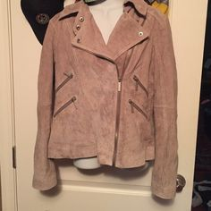 Michael Kors Suede Jacket Very unique!! Light brown beautiful color, zipper detail, side zip, this jacket has it all!!! Like brand new. No stains, etc that I can find. I just don't wear it, so u get a great item for your wardrobe. This jacket isn't heavy, it's actually real light.  Make me an offer!! Michael Kors Jackets & Coats