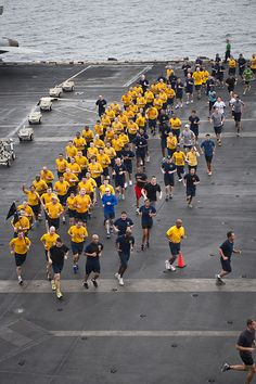 GULF OF OMAN (Aug. 25, 2013) Chief petty officer selectees and other Sailors participate in a 5K run on the flight deck of the aircraft carrier USS Nimitz (CVN 68). Nimitz Strike Group is deployed to the U.S. 5th Fleet area of responsibility conducting maritime security operations, theater security cooperation efforts and support missions for Operation Enduring Freedom. (U.S. Navy photo by Mass Communication Specialist 3rd Class Raul Moreno Jr./Released)