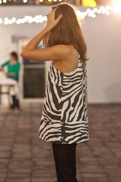 emerson made  a-line mod top   zebra printed linen, two welt pockets, hook & eye closure