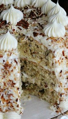 Italian Cream Cake - Melissa's Southern Style Kitchen _ I like the depth of flavor you gain by adding brown sugar & a touch of almond extract. Toast the coconut, adding spectacular flavor!