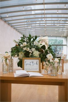 Guest book only/ gold frame/ texture to frame/ playful font/ There will be a floral arrangement , but not as pictured.