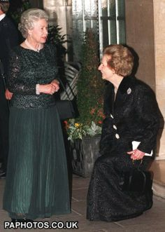 Former prime minister Margaret Thatcher curtsies before the Queen