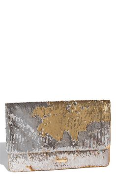 Shimmering gold sequins that flip to reveal occasional flashes of silver elevate a radiant envelope clutch