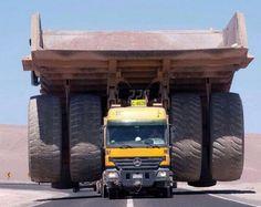 MB Actros pulling 308 ton mining dump truck.