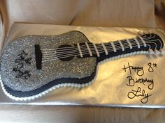 Taylor swift guitar cake  I will need to find someone who can make this for my daughter!