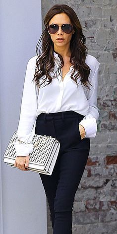 .VICTORIA BECKHAM oh so chic in basic timeless clothing with an edgy textured clutch. Love the outfit!!