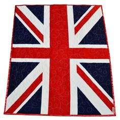 *** Due to lots and lots of wonderful orders, production time on this quilt is approximately FOUR WEEKS-- please know that I will make your quilt to order and it will ship FOUR WEEKS after the date of your purchase. THE LAST DAY TO ORDER FOR GUARANTEED DOMESTIC DELIVERY BEFORE CHRISTMAS IS 11/15. ***  Handcrafted from a traditional Union Jack cotton panel from fabric designer Riley Blake, this baby quilt is machine quilted in a meandering loopy stipple and backed and wrap-bound in sumptuous…