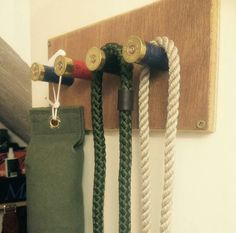 Shotgun Shell Hat Coat Rack - spent shells, cut dowel to fit, glue and screw!