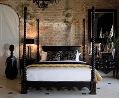 more of an old-world feel with the really cool brick wall, and awesome  bed!