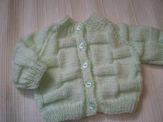 sweet little mint green hand knitted baby by carolinepallett