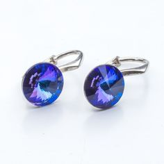 Swarovski Rivoli Earrings 8mm Heliotrope  Dimensions: length: 1,7cm stone size: 8mm Weight ~ 1,85g ( 1 pair ) Metal : sterling silver ( AG-925) Stones: Swarovski Elements 1122 SS39 Colour: Heliotrope 1 package = 1 pair