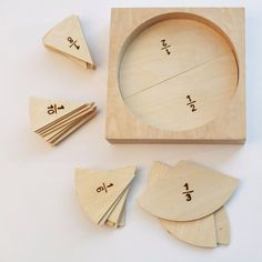 This portable math set for fractions is neatly packaged in a wooden box which transforms itself into a presentation tray when flipped. The set includes 55 pieces of fractions in 10 groups: 1 ABOUT OUR PROCESS Each of our products Montessori Materials, Montessori Activities, Activities For Kids, Dinosaur Activities, Learning Fractions, Math Fractions, Sensory Integration Therapy, Material Didático, Math Manipulatives