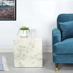 Make a statement in your living room with a white side table with faux marble finish. #livingroom #whitesidetable #sidetable #marblesidetable #whitelivingroom #livingroomdecor #whitehome #whitedecor #marbletable Large Furniture, New Furniture, Online Furniture, Living Room Furniture, Living Room Decor, Living Spaces, Furniture Design, Cube Side Table, White Side Tables